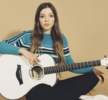 ade Bird with her Taylor Guitar
